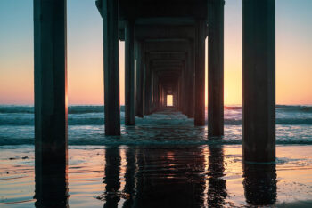 Sunset at La Jolla Pier with the best ocean waves beneath it. Limited edition print by Rick Ryan. Purchase your large, framed wall decor.