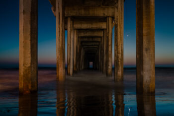 Stars meet sunset at La Jolla Pier, best ocean waves beneath it. Limited edition print by Rick Ryan. Purchase your large, framed wall decor.